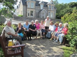 Garden volunteers having a cuppa at the end of an afternoon's work.